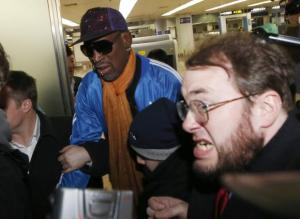 Bodyguards clear a path for former NBA basketball player Dennis Rodman (C) as journalists surround him upon his arrival from North Korea's Pyongyang at Beijing Capital International Airport January 13, 2014. CREDIT: REUTERS/KIM KYUNG-HOON